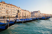 Gondolas in front of the quay with old buildings of Venice — Stock Photo