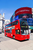Red double decker bus at the Piccadilly Circus in London, UK — Stock Photo