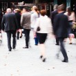 Crowd of dressed up people in motion blur walking to a concert — Stock Photo #63161497