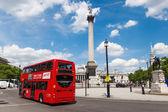 Red bus on the Trafalgar Square in London, UK — Stock Photo