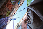 Laundry lines in a low angle view in an old alley of Venice, Italy — Stock Photo