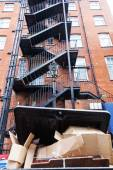 Backyard view of an old brick building with fire exit stairs — Stock Photo