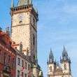 Historical City Hall Tower with the famous astronomical clock and Church of Our Lady before Tyn at the Old Town Square in Prague, Czechia — Stock Photo #63209811