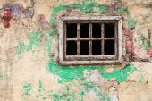 Window at an decayed wall — Stock Photo