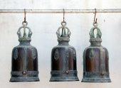 Buddha brass bell hanging  on iron tube — Stock Photo