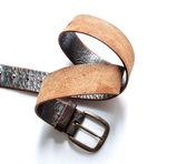 Old vintage natural leather belt on white — Zdjęcie stockowe