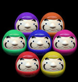 Daruma doll in mix color concept in white isolate background — Stock Photo