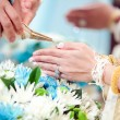 Hand of a bride receiving holy water from elders in thai culture — Stock Photo #67826131