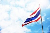 Thailand flag on the blue sky and lens flare light — Stock Photo