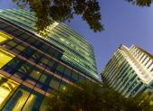 New modern glass Office buildings serve several needs of people in big city of Bangkok with best security system to offer and privacy to comfortably live, work, and excercise at one of the best gym — Stock Photo