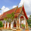 Thai Buddhist temple and a monk — Stock Photo #58103355