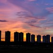 Row of condominiums at sunset with multicolored sky — Stock Photo #58103395