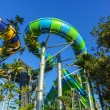 Huge Jungle Water Tube Slides in water theme park look exiting and are perfect attractions for both young and adults during holidays. Visitors and tourists enjoy the curves and speed while playing — Stock Photo #63734075