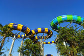 Huge Jungle Water Tube Slides in water theme park look exiting and are perfect attractions for both young and adults during holidays. Visitors and tourists enjoy the curves and speed while playing — Stock Photo