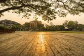 Reflection of sunset upon wooden floor — Stock Photo