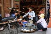 Street vendor selling traditional food — Stock Photo