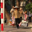 Street vendor sells items from baskets — Stock Photo #52031359