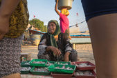 Fish monger, Jimbaran fishing village, Bali Island — Stock Photo