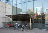 Bicycle shed in modern building — Stock Photo