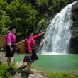 Yao tribe maidens at waterfalls — Stock Photo #72528467