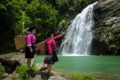 Yao tribe maidens at waterfalls — Stock Photo
