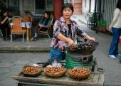Roasted chestnut seller — Stock Photo