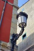 Lamppost and red wall — Foto Stock