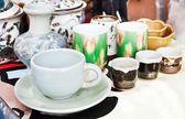 Enamel plates, bowls and mugs stacked — Stock Photo