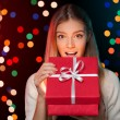 Happy girl in excitement opening Christmas box which is glowing inside. Excited woman. Christmas Gift — Stock Photo #58514567