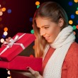 Happy girl in excitement opening Christmas box which is glowing inside. Excited woman. Christmas Gift — Stock Photo #58514575