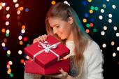 Happy girl in excitement opening Christmas box which is glowing inside. Excited woman. Christmas Gift — Stock Photo