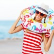 Happy woman wearing sunglasses and hat — Stock Photo #64968677
