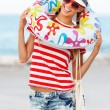 Woman wearing sunglasses and beach hat — Stock Photo #64969275