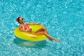 Sexy woman in bikini in pool — Stock Photo