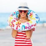 Happy beach woman wearing sunglasses — Stock Photo #70083097