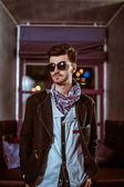 Young stylish sexy handsome model man in casual cloth lifestyle in glasses — Stock Photo