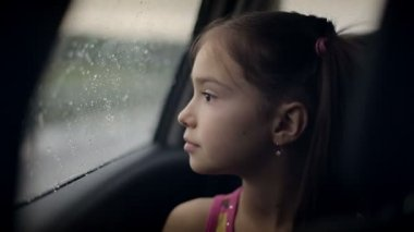 Child female in the car in raining — Stock Video