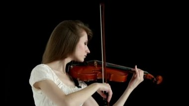 Caucasian violinist girl on a black background. — ストックビデオ