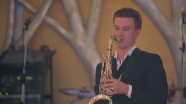 Saxophone player performs on stage. — Stock video
