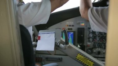 Cockpit inside. Hands pilots run gadgets of seaplane. Video with sound. — Stock Video