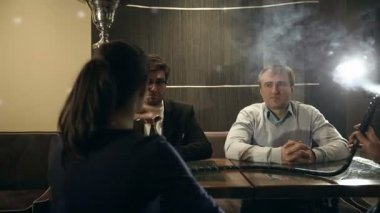 Company people enjoy hookah and communication. — Stock Video