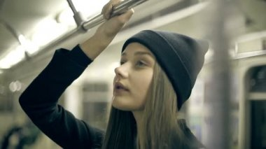 Teen girl rides the metro at night — Stock Video
