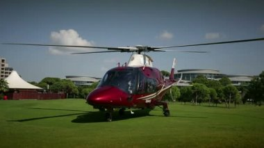 Helicopter starting with the beautiful green takeoff area — Stock Video