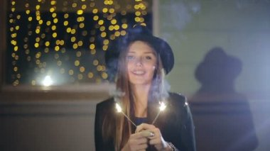 SLOW MOTION: Portrait of a girl model looks with sparklers in their hands — Stock Video
