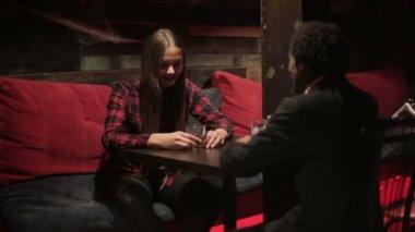 White woman and black man make dialogue at restaurant. Different race friends. — Vídeo de Stock