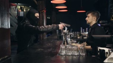 Successful bar robbery. The robber breaks into a bar and takes the money — Stock Video