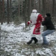 Santa Claus is fighting in the woods with robbers. Slow motion — Stock Video #63812255