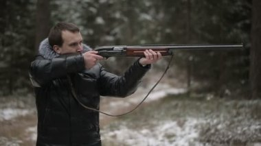 Hunter shoots a gun and fly cartridge and second man forbids him to shoot — Stock Video