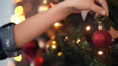Child girl decorates the Christmas tree. HD shot with slider. — Stock Video