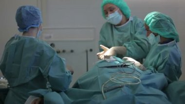 RUSSIA, S.PETERSBURG 2013: Plastic surgeon and an assistant make man operation — Stock Video
